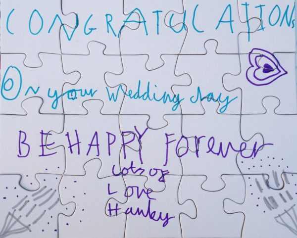 """homemade puzzle by a child: """"CONGRATULATIONS on your Wedding day BE HAPPY forever lots of LOVE Hanley"""""""